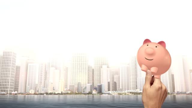 Hand Holding A Pink Piggy Bank