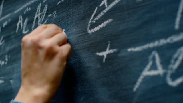 Hand Holding Chalk and Writing Complex and Sophisticated Mathematical Formula on the Blackboard. Underlining Equation. Hand Holding Chalk and Writing Complex and Sophisticated Mathematical Formula on the Blackboard. Underlining Equation. Shot on RED EPIC-W 8K Helium Cinema Camera. blackboard visual aid stock videos & royalty-free footage