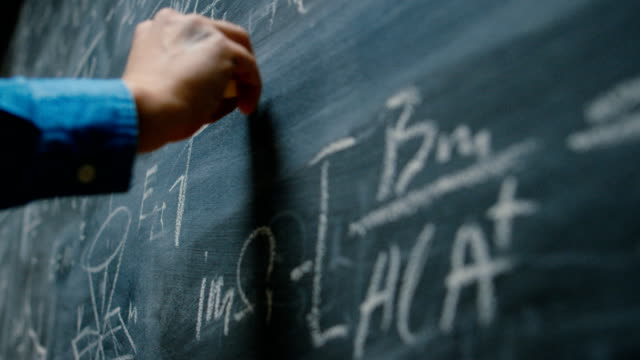 Hand Holding Chalk and Writing Complex and Sophisticated Mathematical Formula/ Equation on the Blackboard. Hand Holding Chalk and Writing Complex and Sophisticated Mathematical Formula/ Equation on the Blackboard.  Shot on RED EPIC-W 8K Helium Cinema Camera. mathematics stock videos & royalty-free footage