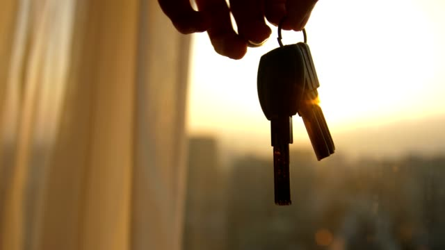 hand holding keys of a new home - key ring stock videos & royalty-free footage