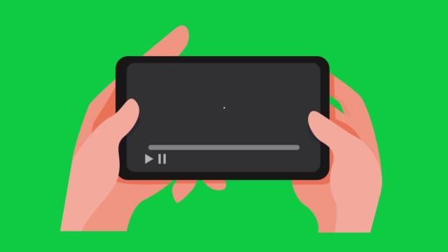 handhalten smartphone beobachten streaming-video mit puffer-ladebildschirm in grünem hintergrund geeignet für motion-grafik-video - live ereignis stock-videos und b-roll-filmmaterial