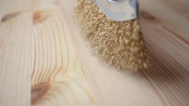 Hand holding steel brush Brushing Wood close-up video