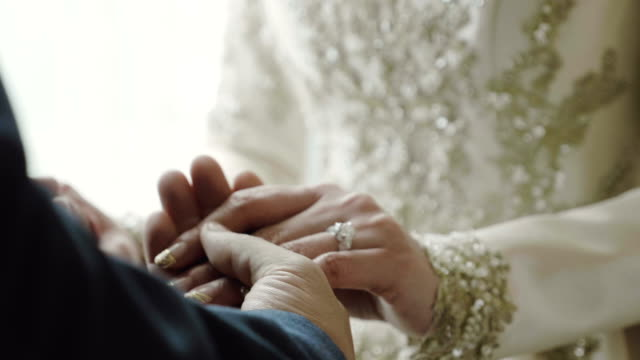 hand holding - young couple wedding friends video stock e b–roll