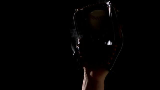 Hand in baseball mitt catching glove video