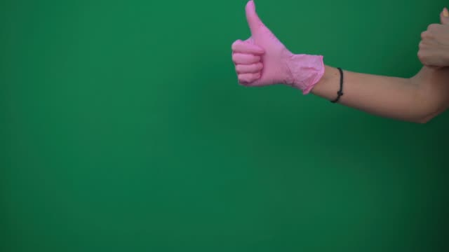 hand in pink glove on green background hand in pink glove on green background chlorine stock videos & royalty-free footage