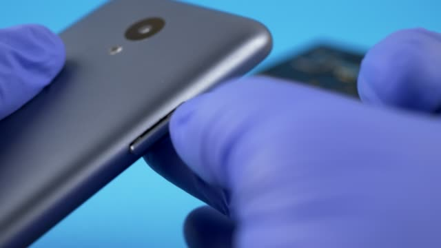Hand in White Gloves Take Out Nano SIM Card from Smartphone