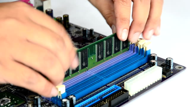 Hand installing Random Access Memory (RAM) into Motherboard video
