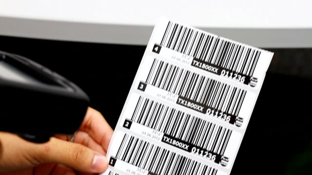 Hand is holding a handheld and read the barcode. video