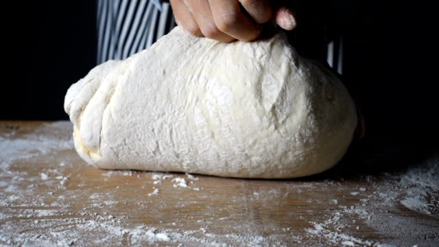 hand kneading dough - impasto video stock e b–roll