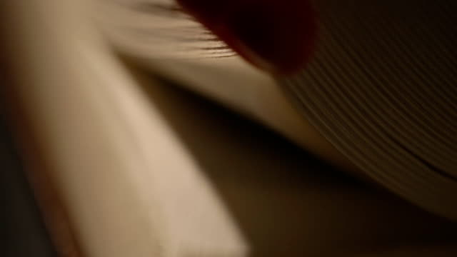 Hand leafing through an old book pages video