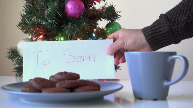 Hand leaving cookies out for Santa Claus video