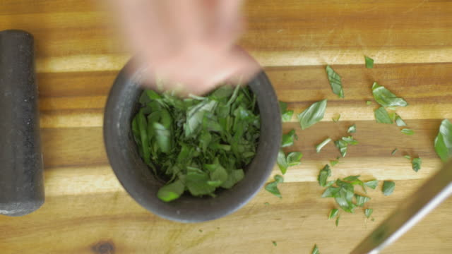 hand making basil paste hand make basil paste by using Mortars & Pestles mortar and pestle stock videos & royalty-free footage