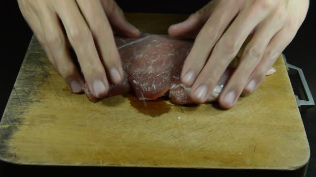 hand marinated raw pork tenderloin with salt and pepper video