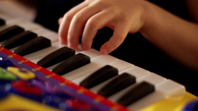 Hand of a child playing keys video