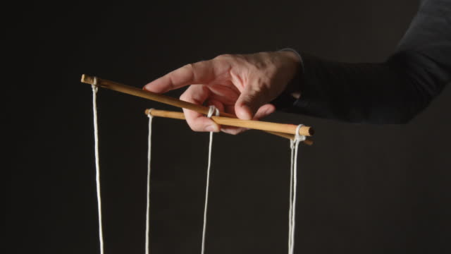 MANIPULATION: Hand of a puppeteer MANIPULATION: Hand of a puppeteer marionette stock videos & royalty-free footage