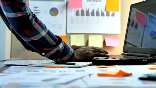 hand of businessmen using laptop examine account calculated financial reporting, with charts, graphs. the concept of business finance and accounting and business startup, online marketing - balance video stock e b–roll