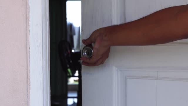 hand of man closing the door.