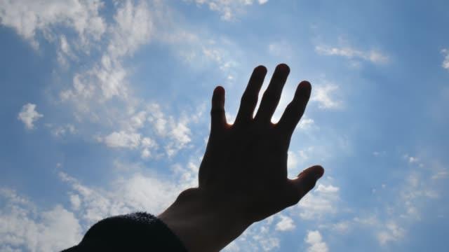 hand of man on deep blue sky. - avvicinarsi video stock e b–roll