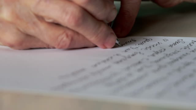 hand of old woman writing letter video