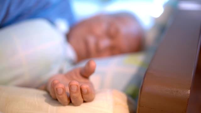 Hand of Sleeping Senior Asian man