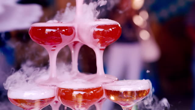 Hand of the waiter in white gloves pour steaming champagne at a party video