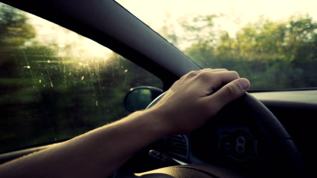 Hand on a wheel Human hand holding the steering wheel. wheel stock videos & royalty-free footage