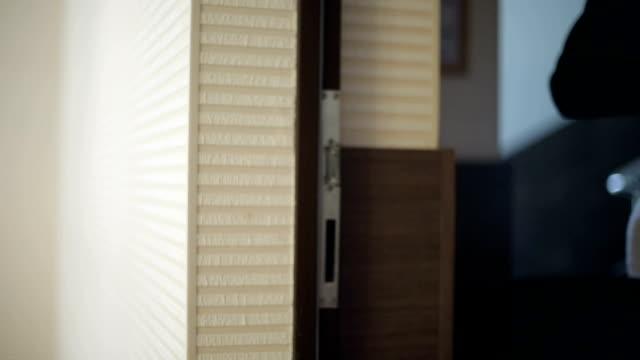 Hand open door in a office video