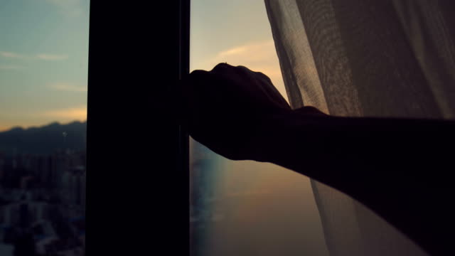 Video Hand open window in the morning