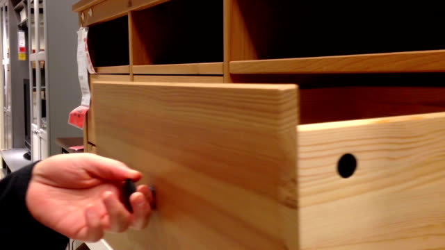 A hand opens a drawer in cabinet video
