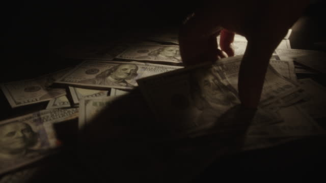 Hand Picking Up U.S. Dollars From Table, Net Filter, Shallow Focus