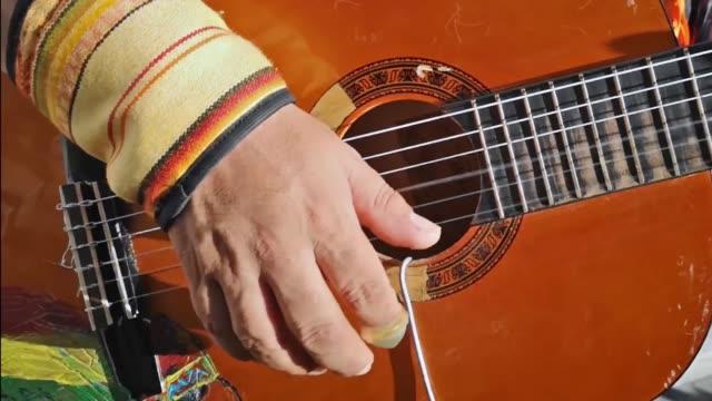 hand spela gitarr musik instrumenterar - latino music bildbanksvideor och videomaterial från bakom kulisserna