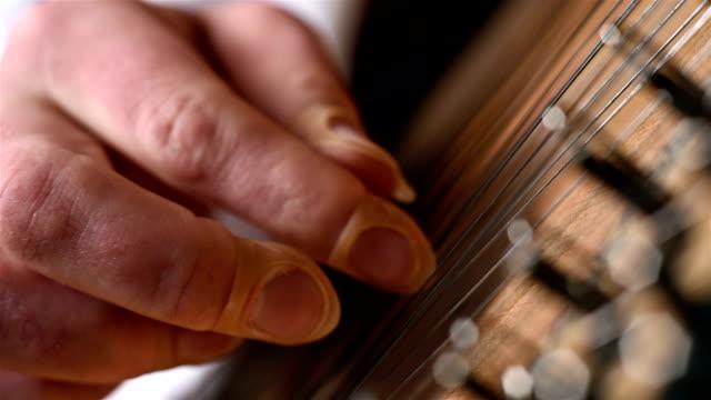 Hand Playing The Bandura video