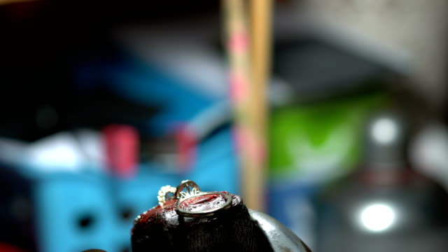 Hand polishing gold jewelry ring jeweler. Production and making manufacturing video