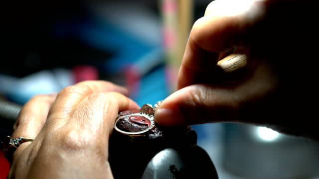Hand polishing gold jewelry ring jeweler. Production and making manufacturing