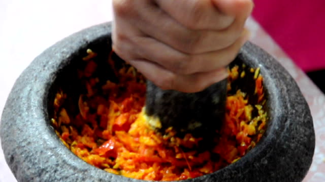 Hand pounding spices in stone mortal-traditional Thai curry paste making Hand pounding spices in stone mortar - traditional Thai curry paste making  (with sound) mortar and pestle stock videos & royalty-free footage