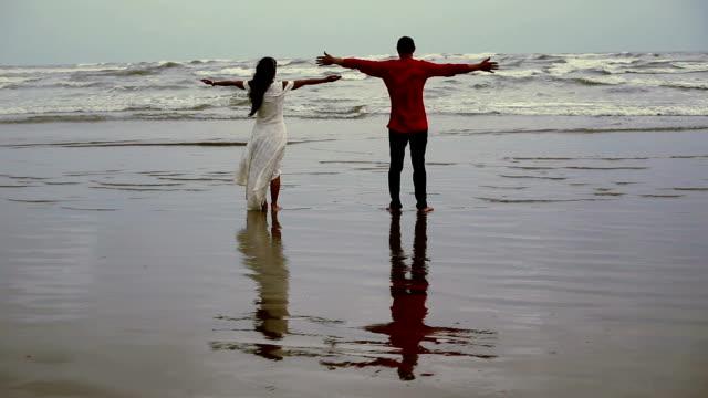 Hand raised on summer beach video