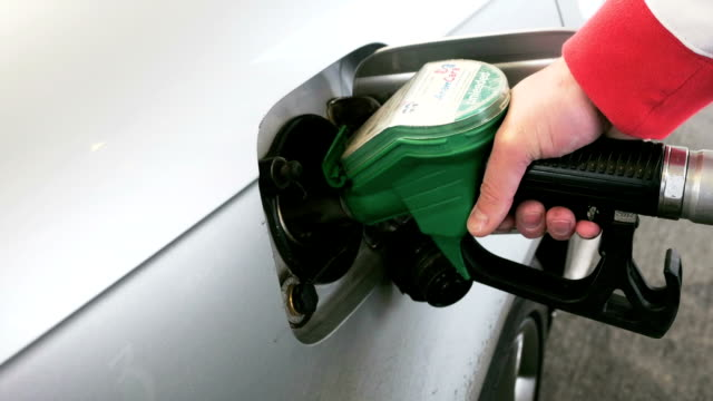 Hand refilling the car with fuel video