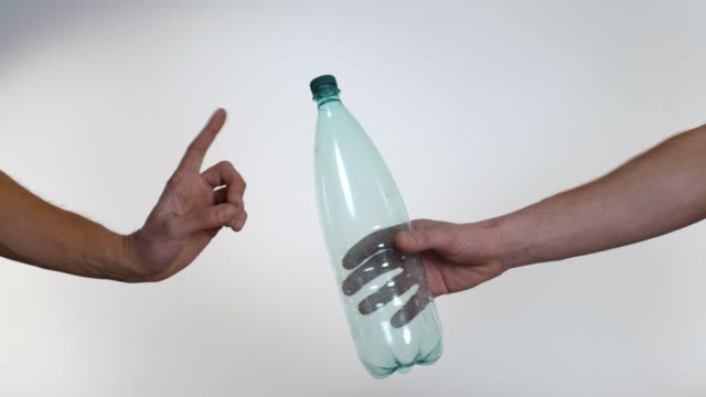 hand refuses plastic bottle in favor of reusable glass bottle, plastic pollution - frugal lifestyle stock videos and b-roll footage