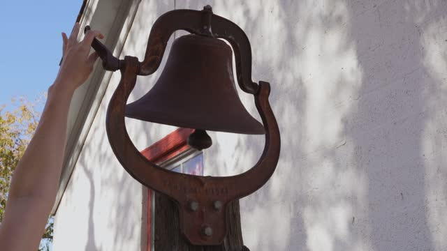 hand ringing old antique bell video