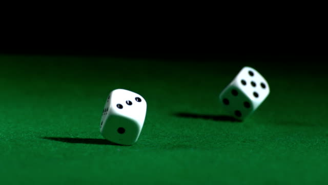 Hand rolling white dice video