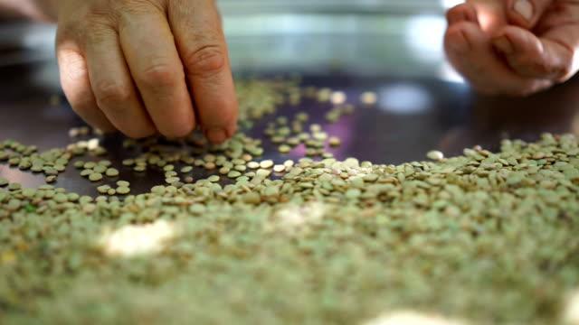 Hand select lentils video