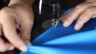 istock Hand sewn blue fabric with old sewing machines. 1203759001