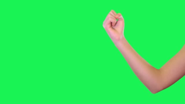 hand sign of female hand in front of green screen. - pugno video stock e b–roll