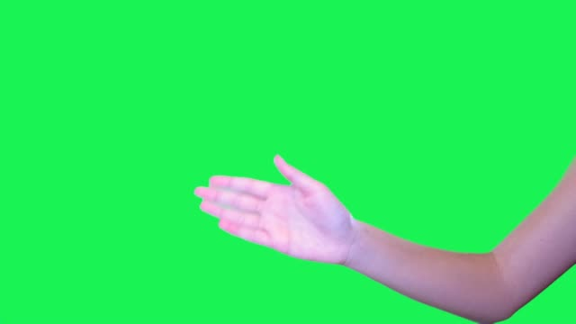 Hand sign of female hand in front of green screen. video