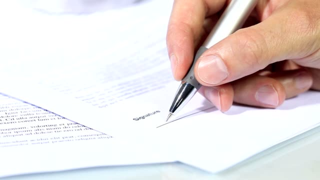 hand signing a document, signature concept video