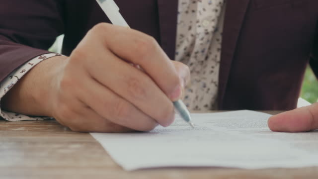 Hand Signing Contract Signature house rental stock videos & royalty-free footage