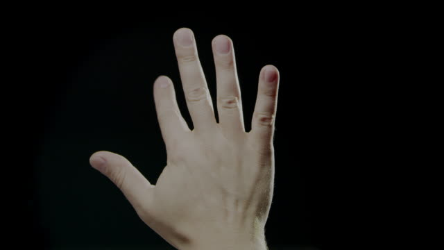 hand signs language slow motion caucasian human black background - palm of hand stock videos & royalty-free footage