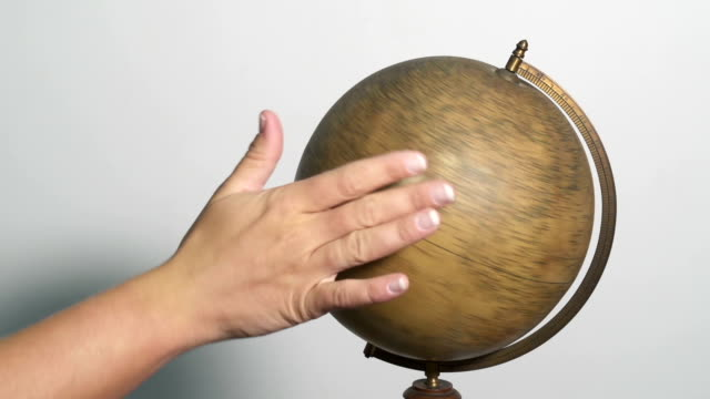Hand spinning a globe video
