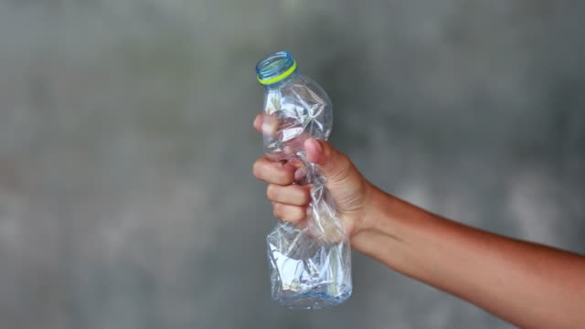 Hand squash a plastic bottle Hand squash a plastic bottle bottle stock videos & royalty-free footage