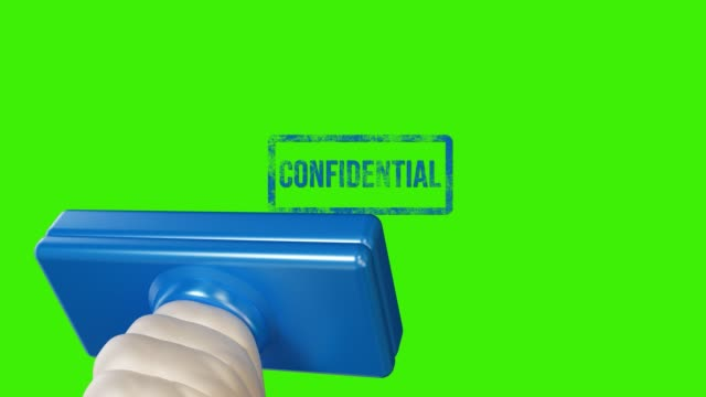 hand stamping confidential on green screen